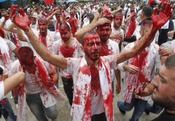 Shi'ite Muslims bleed after tapping their foreheads with a razor during a Muharram procession to mark Ashoura in Nabatieh town, southern Lebanon