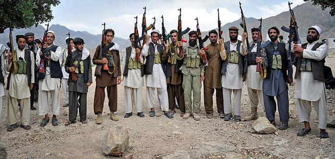 Armed Afghan villagers raise their weapons as they vow to defend their village against the Taliban in Sor Kandaw village, Dur Baba district of Nangarhar province on May 21, 2012.  Taliban fighters are being pushed out of some areas in eastern Afghanistan by local militias defending their villages, according to local leaders.   AFP PHOTO/Noorullah ShirzadaNoorullah Shirzada/AFP/Getty Images